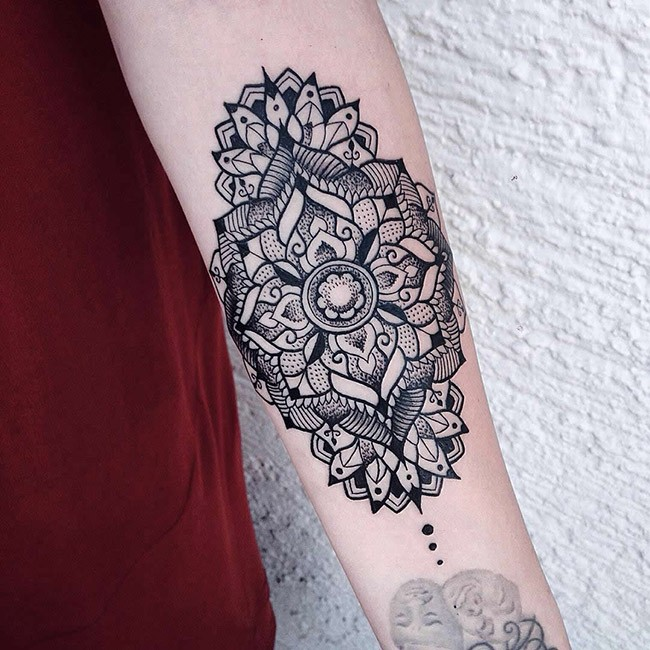 Blackwork style very detailed forearm tattoo of big ornamental flower