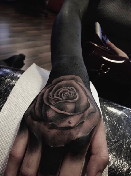 Blackwork style very detailed rose tattoo on sleeve