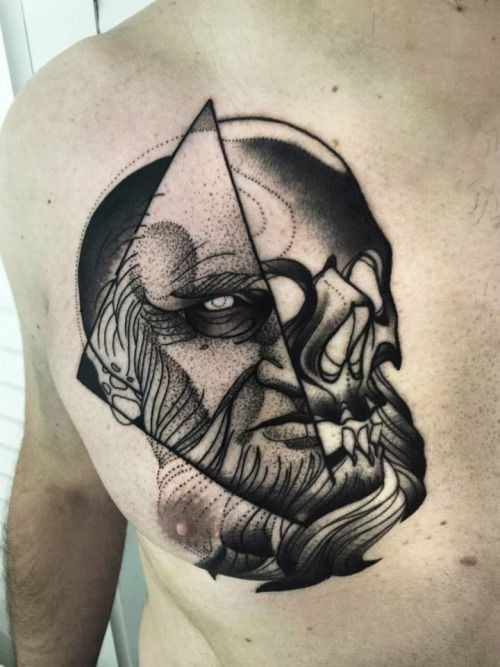 Blackwork surrealism style painted by Michele Zingales chest tattoo of human face combined with skull