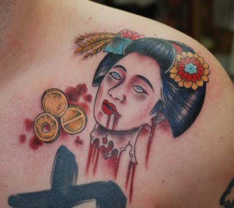 Bloody colored shoulder tattoo of Asian geisha severed head with coins