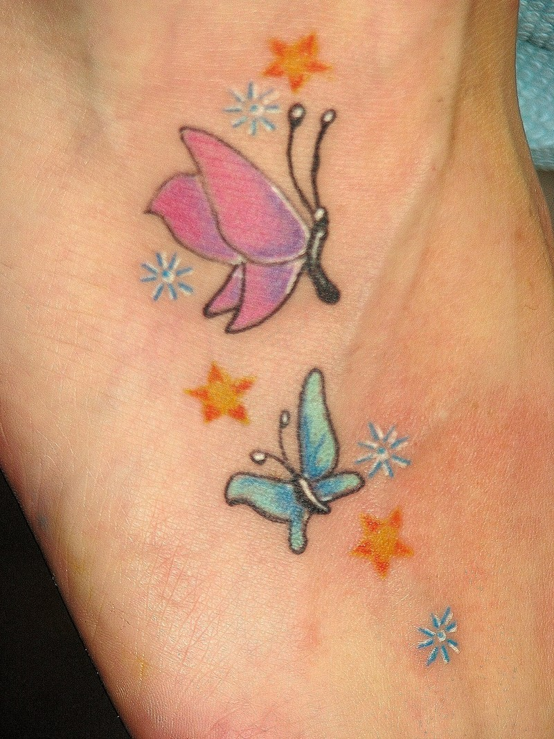 Blue and pink small butterfly tattoo with stars