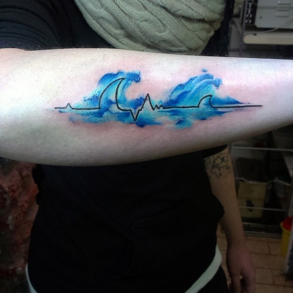 Blue colored waves shaped heart rhythm tattoo on arm