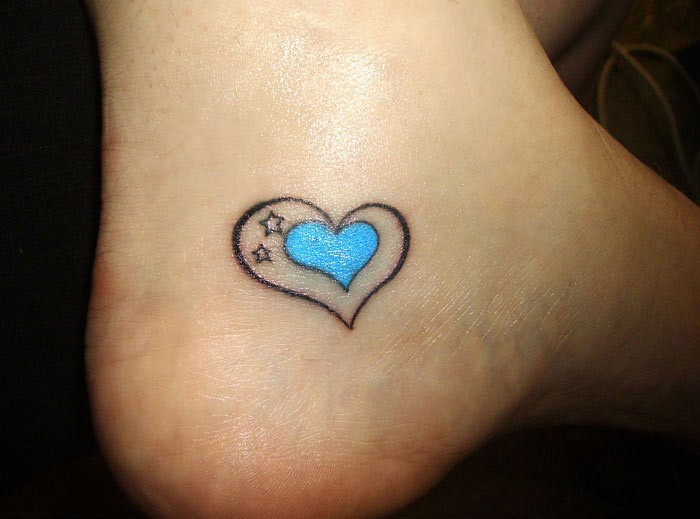Blue heart with stars small ankle tattoo