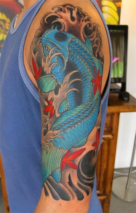 Blue koi fish tattoo on arm for Red koi tattoo