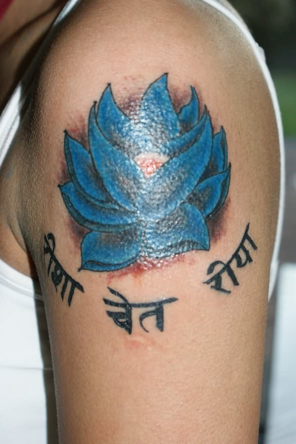 Blue lotus with hindu writings tattoo