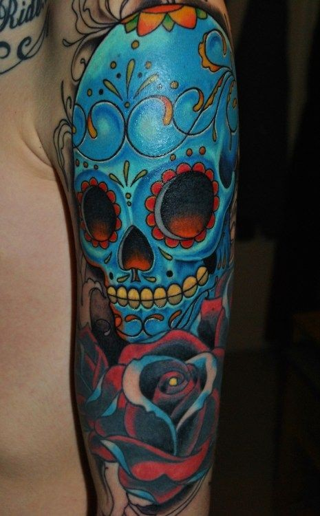 Blue mexican sugar skull tattoo on arm