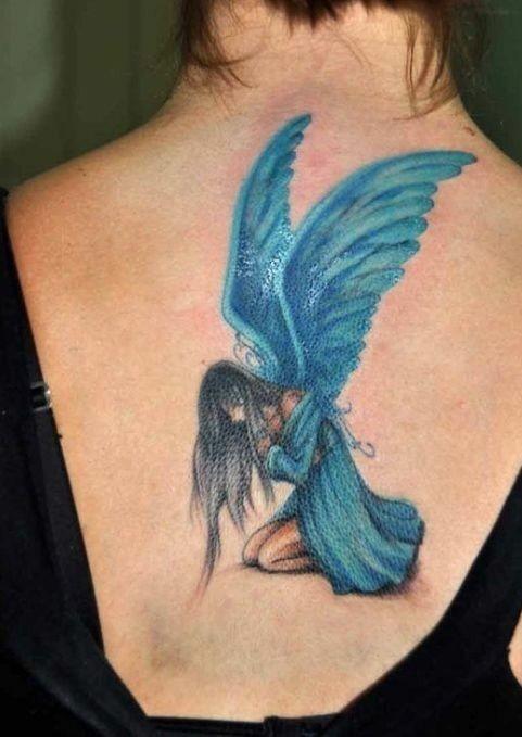 fata blu triste tatuaggio sulla sciena