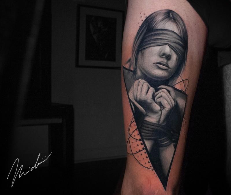 Bound woman tattoo on leg