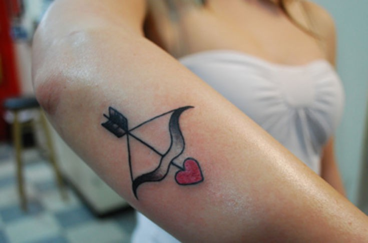 Bow and arrow tattoo with heart