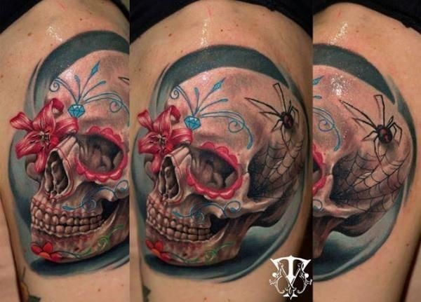 Breathtaking 3D style colored shoulder tattoo of human skull stylized with flowers and spider