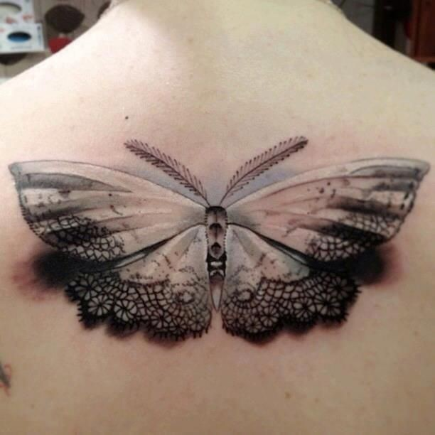 Breathtaking 3D style very detailed butterfly tattoo on back
