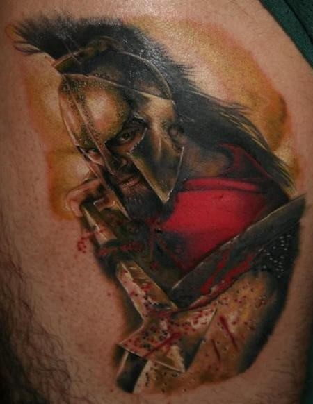 Breathtaking colored thigh tattoo of Spartan warrior with bloody spear