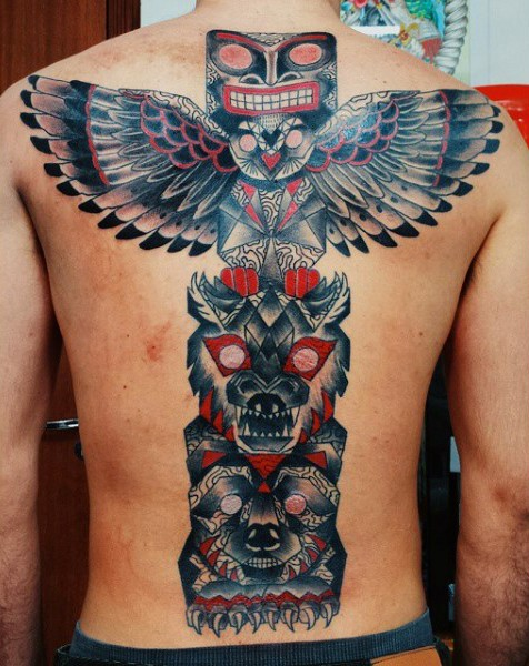 Breathtaking designed massive multicolored tribal statue tattoo on whole back