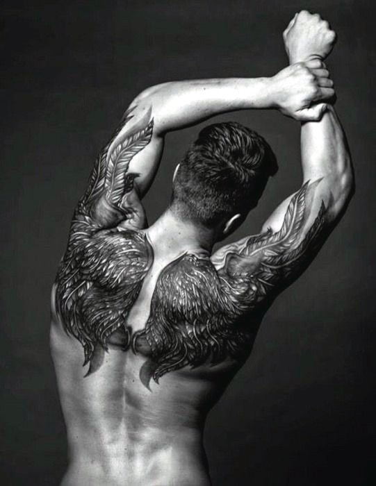 Breathtaking detailed black and white wings tattoo on shoulders