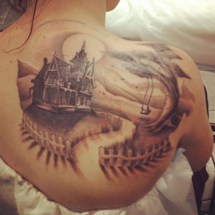 Breathtaking detailed colored old country side house tattoo on back