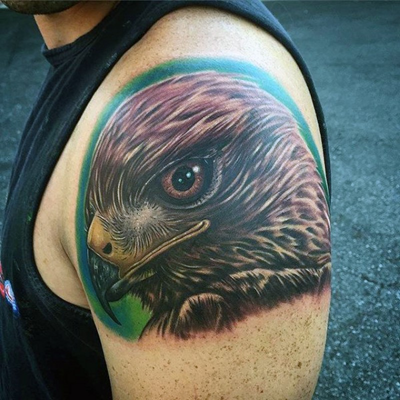 Breathtaking detailed looking colored shoulder tattoo of eagle head