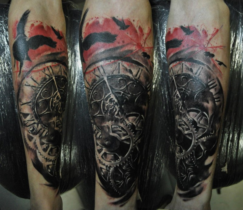 Breathtaking modern style detailed old mechanic clock tattoo on forearm with black crows