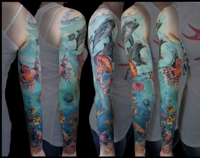 Breathtaking natural looking multicolored underwater like sleeve tattoo