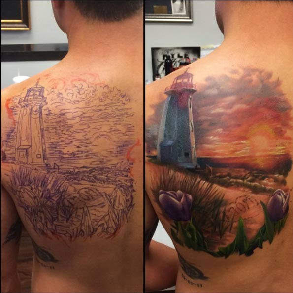 Breathtaking natural looking old lighthouse tattoo on back with flowers and lettering