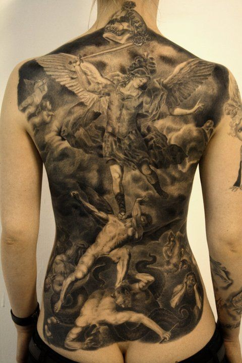Breathtaking painted massive black and white angel warrior fighting demons tattoo on whole back