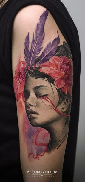 Breathtaking portrait style shoulder tattoo of woman with flowers and feather