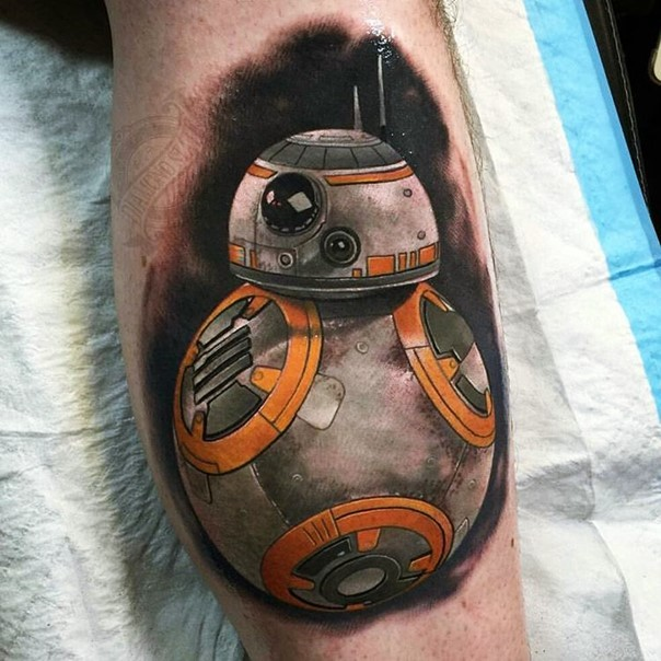 Breathtaking real movie like detailed and colored new Star Wars episode droid tattoo on leg