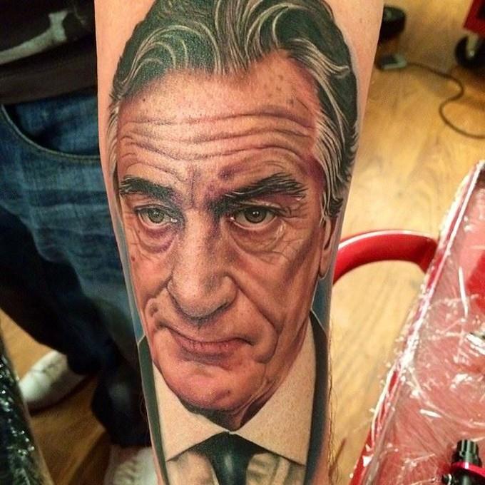 Breathtaking real photo like forearm tattoo of Robert De Niro