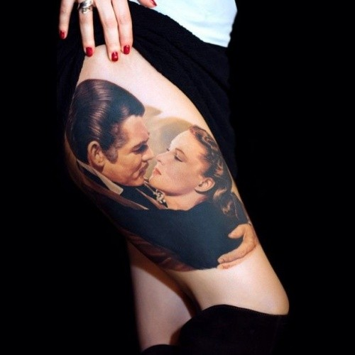 Breathtaking real photo like very detailed thigh tattoo of Gone With the Wind heroes