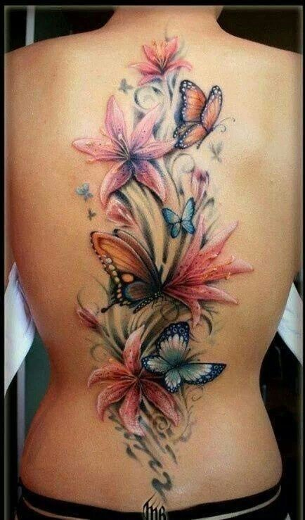 Breathtaking realism style colored whole back tattoo of various flowers and butterflies