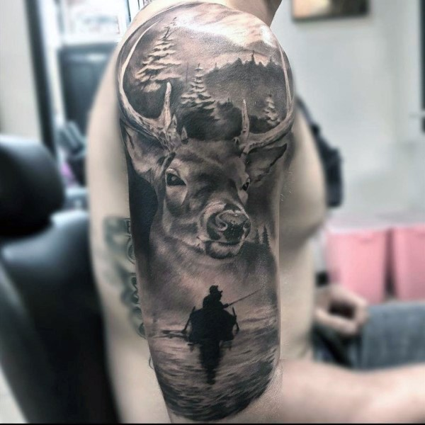 Breathtaking realism style detailed colored shoulder tattoo of deer in forest with fisherman