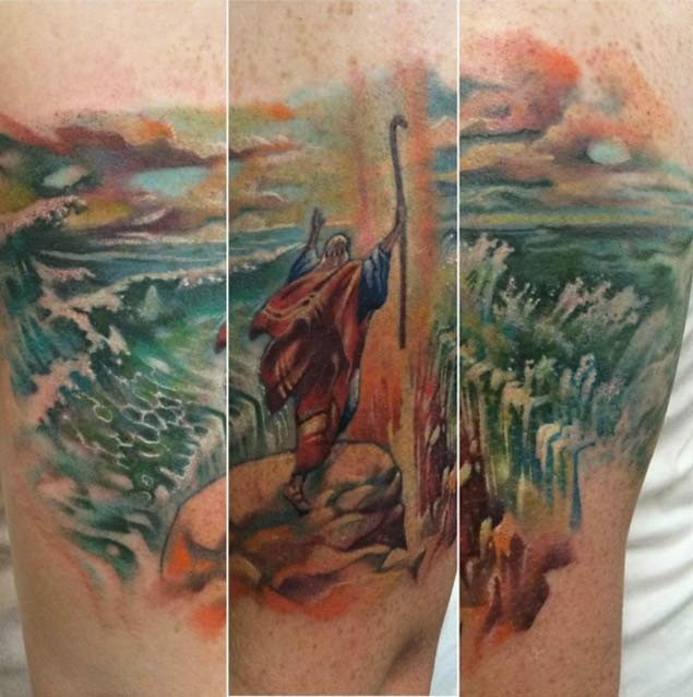 Breathtaking religious themed colored tattoo on arm