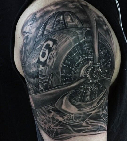 Breathtaking unbelievable realism style very detailed shoulder tattoo of fighter plane
