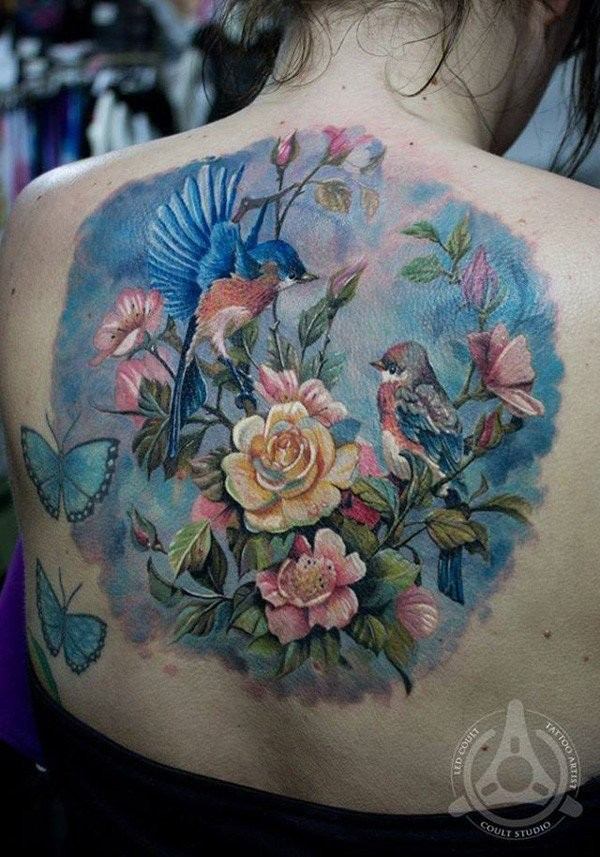 Breathtaking very beautiful colored natural looking birds tattoo on back with blooming tree