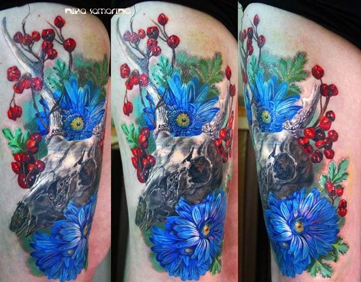Breathtaking very detailed animal skull tattoo on thigh combined with various colored flowers