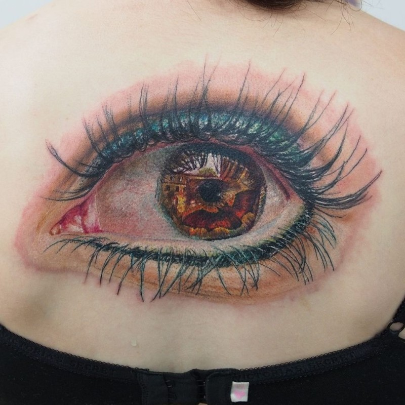 Breathtaking very detailed back tattoo of large woman eye