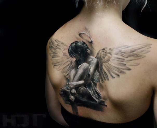 Breathtaking very detailed back tattoo of seductive angel woman