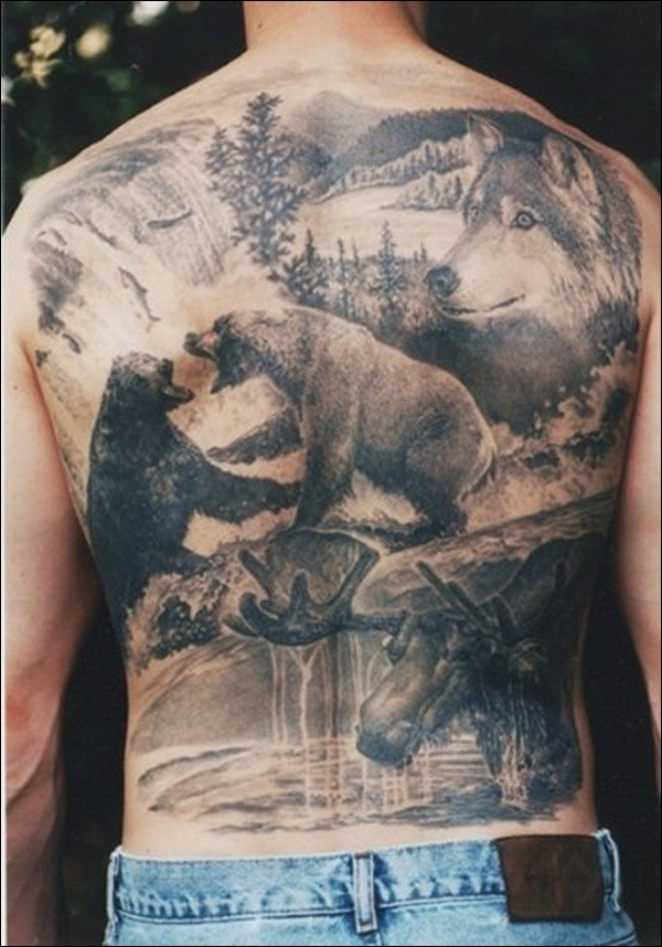 Breathtaking very detailed black and white whole back tattoo of wild life with various animals