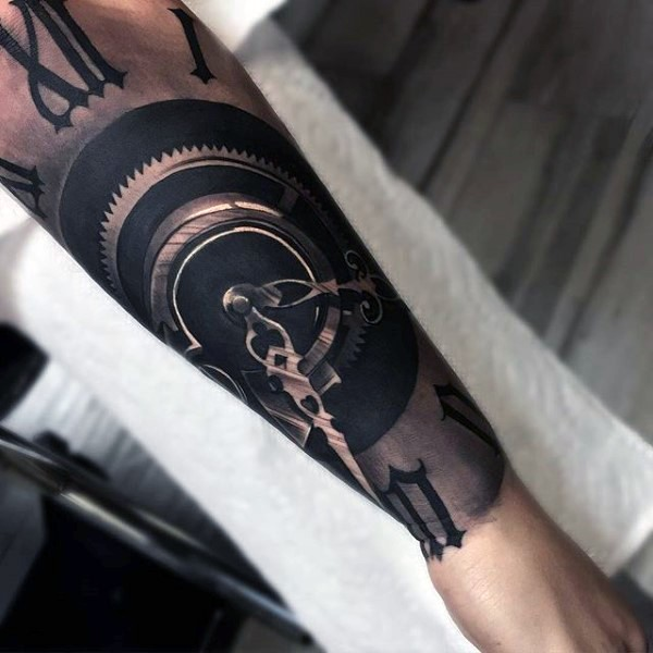 Breathtaking very detailed black ink antic mechanic clock tattoo on forearm