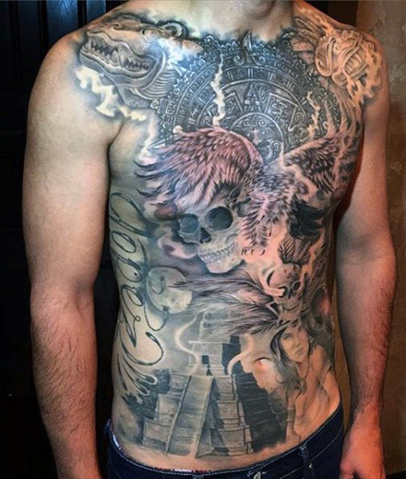 Breathtaking very detailed colored Mayan tribes themed tattoo on whole chest with lettering