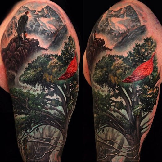 Breathtaking very detailed fantasy forest tattoo on shoulder combined with mountains