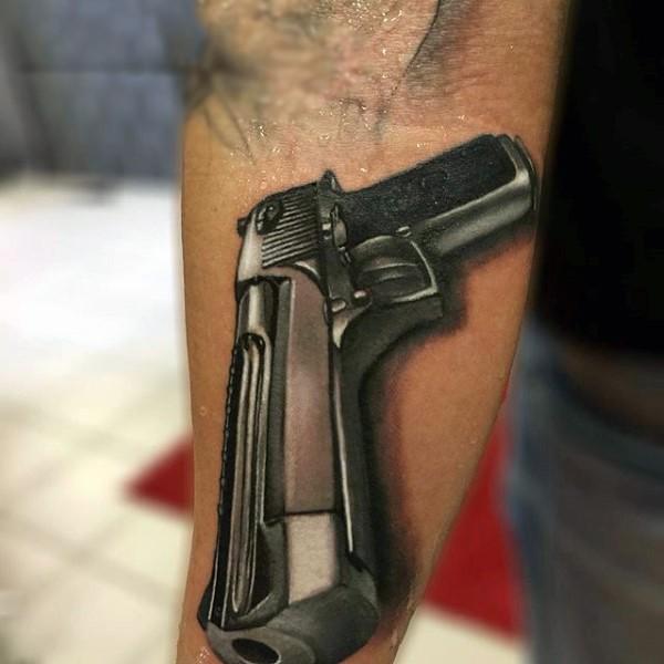 Breathtaking very detailed forearm tattoo of modern desert eagle pistol