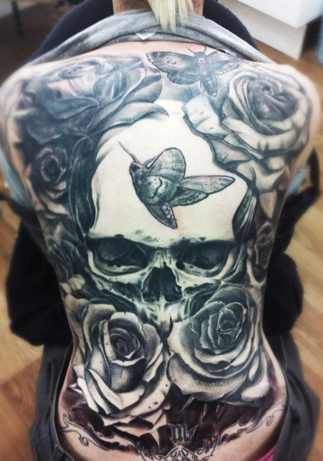 Breathtaking very detailed massive black and white floral tattoo with skull on whole back