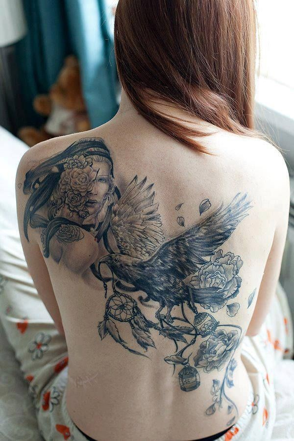 Breathtaking very detailed massive black ink crow tattoo on whole back with woman portrait