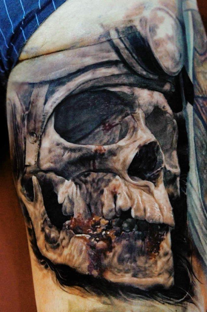 Breathtaking very detailed tattoo of human skull with helmet