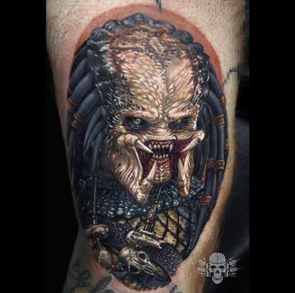 Breathtaking very detailed tattoo of Predator face