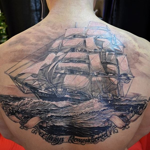 Breathtaking very detailed upper back tattoo of big sailing ship with waves