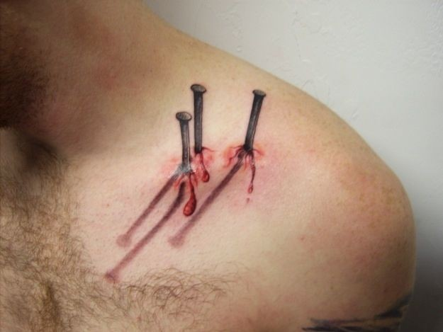 Breathtaking very realistic 3D bloody nails in body tattoo on shoulder