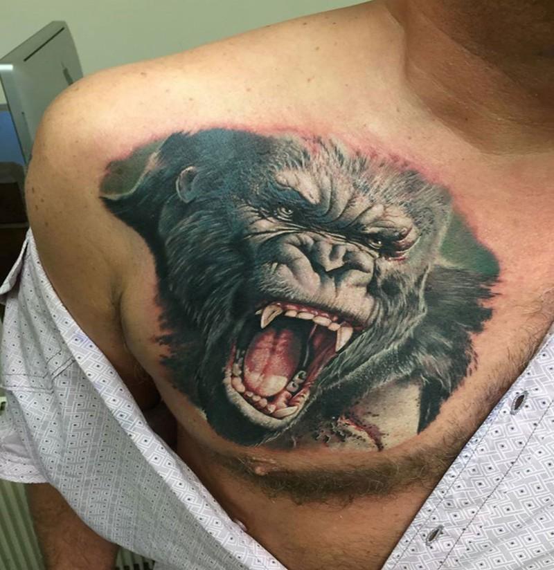 Breathtaking very realistic chest tattoo of roaring gorilla