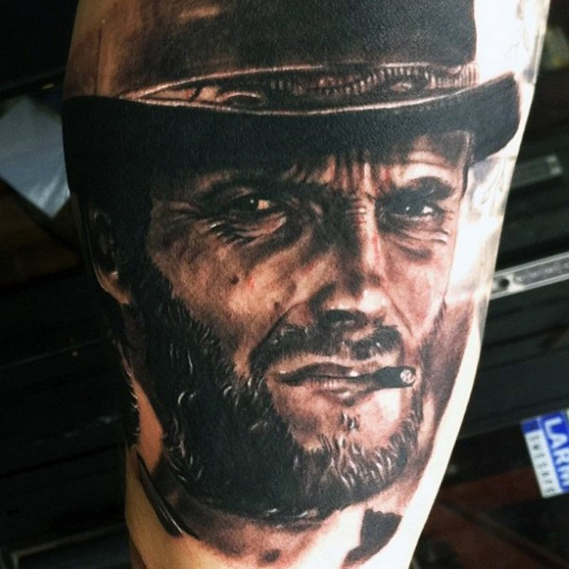 Breathtaking very realistic looking Clint Eastwood like cowboy tattoo on thigh