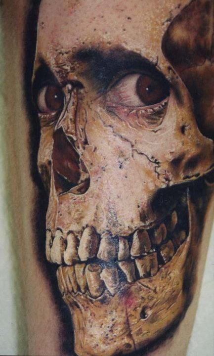 Breathtaking very realistic looking colored alive skull tattoo on arm
